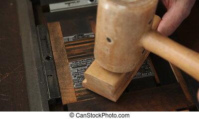 printer prepares type blocks - letterpress printer makes...