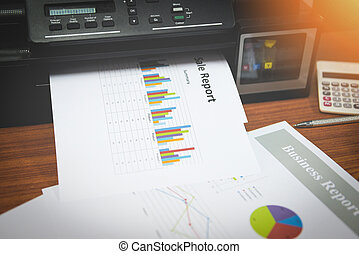 printer printing business reports sale and pile of documents report graph chart on a table office