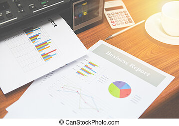 printer printing business reports sale and pile of documents report graph chart on table at office