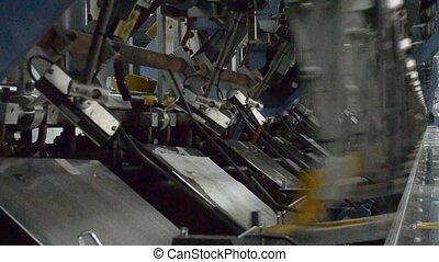 printing - a line of inserting machine inserting printed...