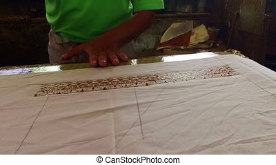 Printing on fabric to make batik in  Java Indonesia