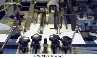 printing press machine - moving white sheets on paper...