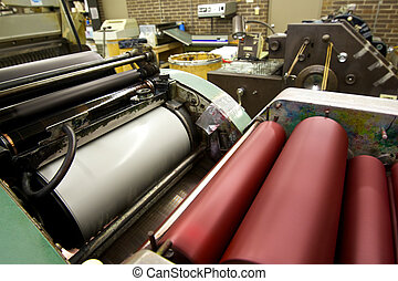 Printing Press - Print rollers on a running press loaded...