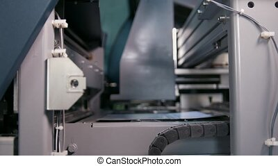 Printing press production line in the printing house, close...