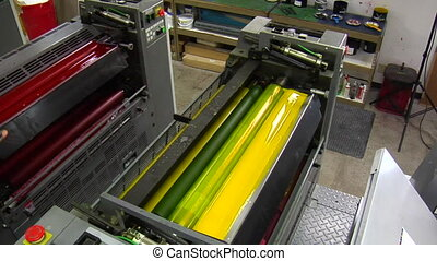 printing press with red ink added