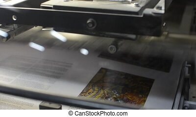 printing - printed copies being collected at the stacker