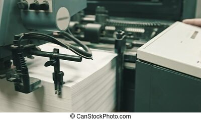 Printing process - feeding sheets of paper at polygraph...