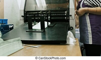Printing Process on polygraph industry - brochures moving on the conveyor belt
