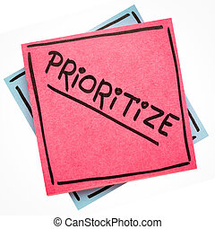 prioritize advice or reminder - handwriting on an isolated sticky note