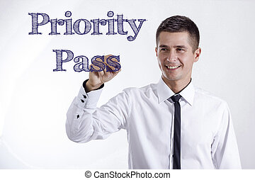 Priority Pass - Young smiling businessman writing on transparent surface
