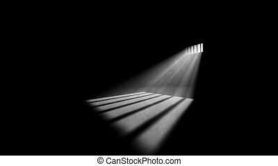 Prison cell with light shining through window