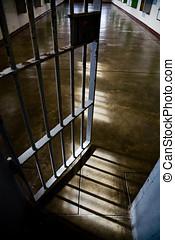 Prison door - Metal bar door and cell in a prison