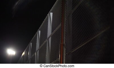 Prison wire fence at night