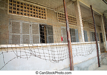 Prison with barbed wire fence.
