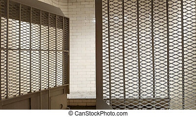 Prison with bars and open cell door