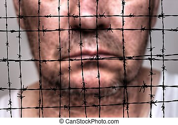 Prisoner against barbwire