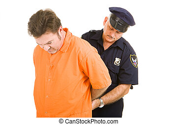 Prisoner and Police Officer - Prisoner in orange jump suit...