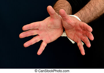 prisoner of war - Concept Photo - Hands of a missing...