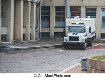 Prisoner transport vehicle standing near the courthouse in Russia.