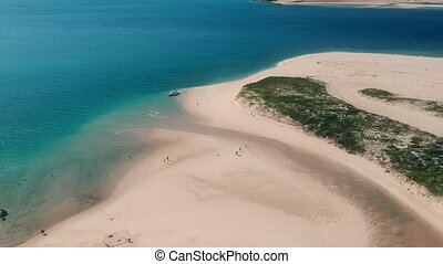 Pristine Sandy Beaches and Vibrant Blue Sea - Pristine sandy...