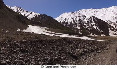 Pristine snow-capped mountains and rocky terrain - View from...
