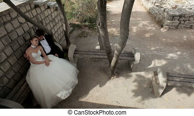 Privacy - Beautiful girl in a wedding dress and a gentleman...