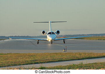 Private business jet on runway