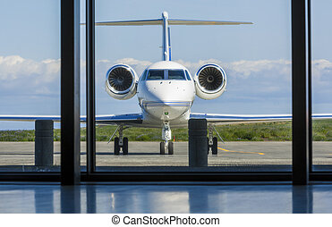 Private Corporate Jet Airplane at an Airport