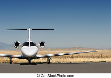 private business jet parked at the airport with copyspace