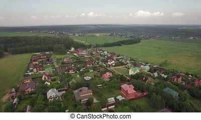 Aerial view of Lukino Village with private houses and vast green areas, Russia