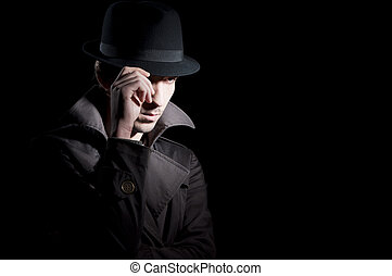 Private investigator - man dressed in a trench with a hat on...