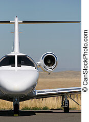 a private corporate jet parked at the airport
