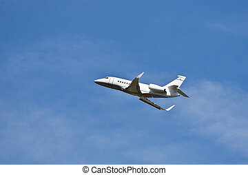 Private jet in the blue sky