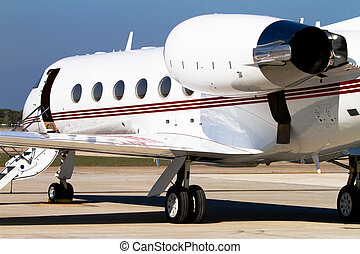 Private Jet - Private jet parked on the tarmac