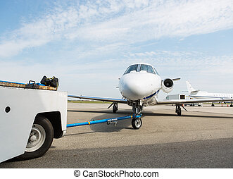 Private Jet Towed By Ground Crew