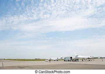 Private Jets On Airfield - Private jets on airfield against...