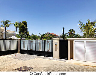 Private modern roof of the house and palm trees in Rishon Le Zion, Israel
