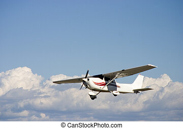 Private Plane - A small prop plane against a blue sky.