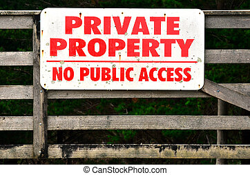 """Private property - A sigh on a fence reads: """"PRIVATE..."""