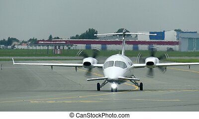 Private turboprop airplane taxiing at the airport - Private...