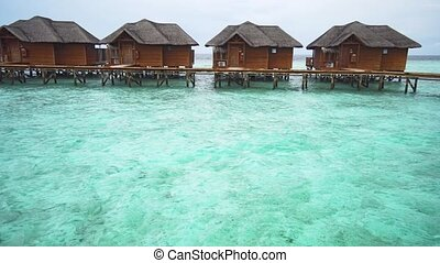 Private Villas on Piers over the Water in the Maldives -...