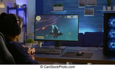 Pro gamer playing space shooter online championship with modern graphics using wireless controller. Competitive player streaming video game tournament using professional equipment at gaming studio
