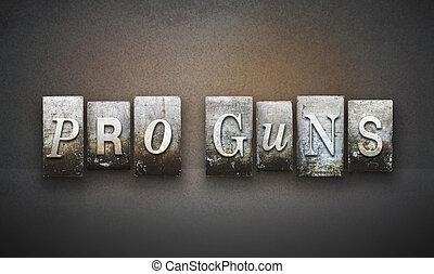 The words PRO GUNS written in vintage letterpress type