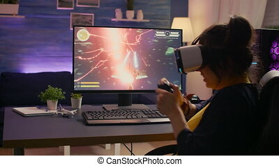 Pro video game r losing space shooter competition while wearing virtual reality headset. Defeated gamer using professional console for online tournament on powerful computer in gaming home studio