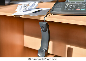 Problem at work, picked up the phone on the desk in the office