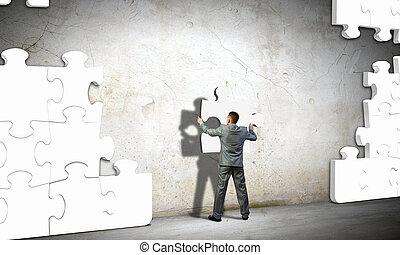 Problem solving - Image of businessman compiling macro white...