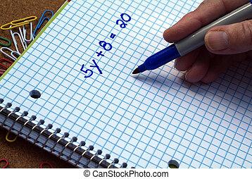 Person solving a Math linear equation problem