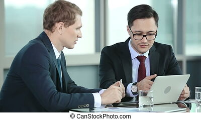 Problem Solving - Two businessmen discussing plans and...