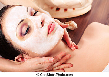 procedures - Portrait of a woman with spa mask on her face. ...