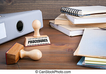 Procedures. Rubber Stamp on desk in the Office